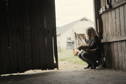 Woman in Barn Struggling with Depression
