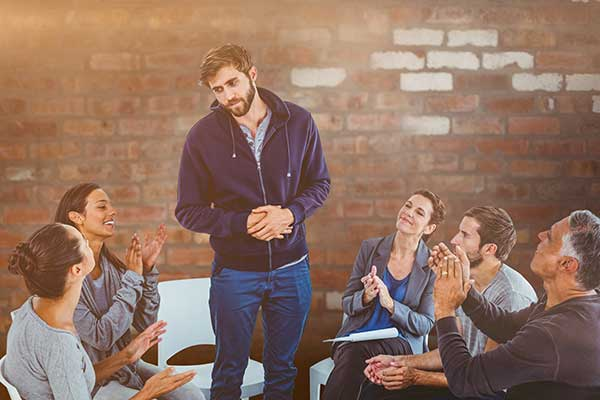 Man Sharing During Group Therapy