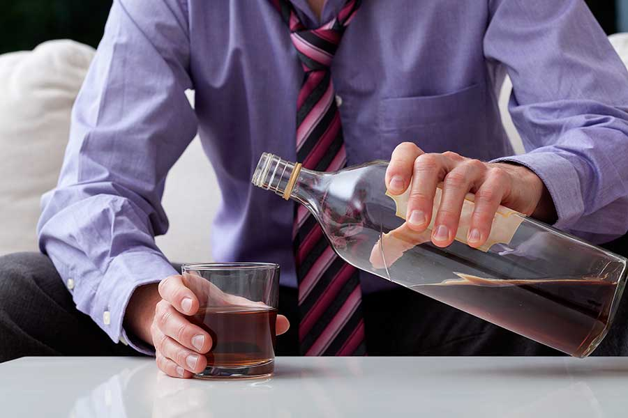 Man Struggling with Alcohol Dependence